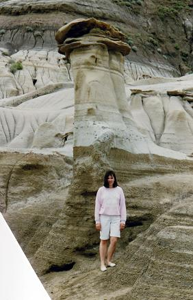Tara standing near a dino, those may have been taken away