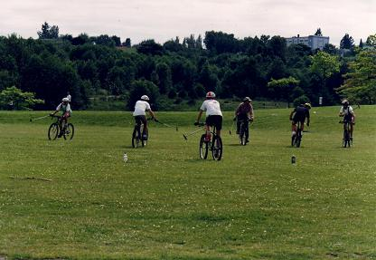 Playing polo on their bicycles in Stanley Park