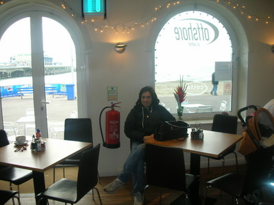 Tara sitting in the Offshore Cafe near the pier