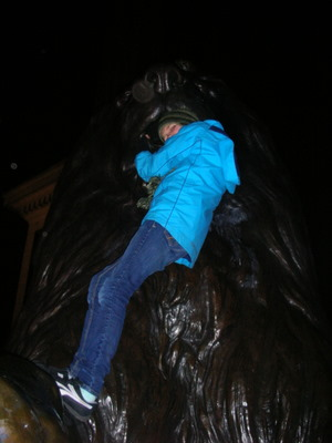 Nadia holding on to the lions of Trafalgar Square