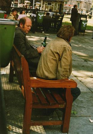 People drinking in London bench