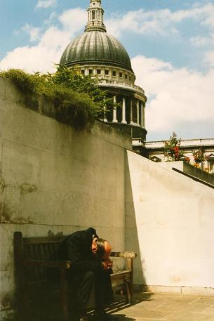 A man praying in front of the St-Paul's Cathedral