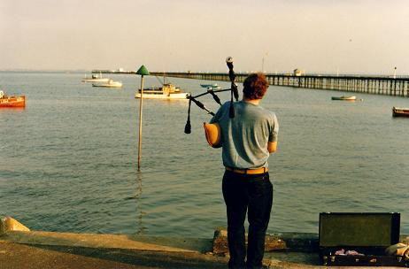 Southend-on-Sea piper playing in front of the pier