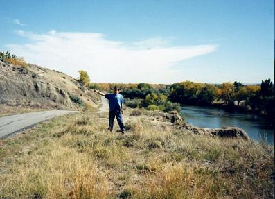 Pretending that I was hitchiking, by the bike trail in Casper. This part of the trail follows the North Platte River.