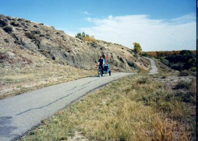 Pulling the kids on a bike carriage, the trail is well-paved