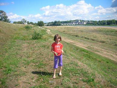 Isabelle by the Loire River with Amboise behind