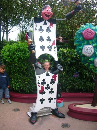 Isabelle standing by a character of Alice in Wonderland