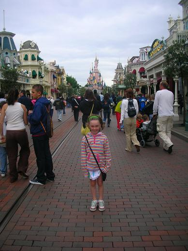 Isabelle standing in Main Street USA in Disneyland Paris