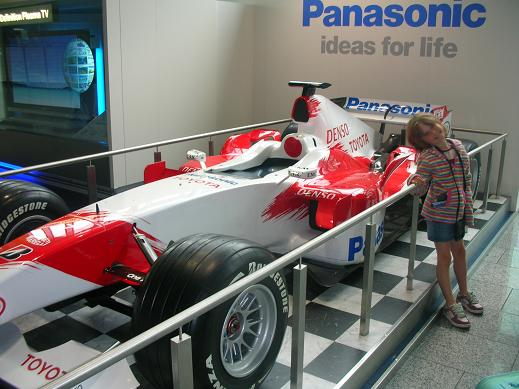 Isabelle in front of Ralf Shumarer's F1 car
