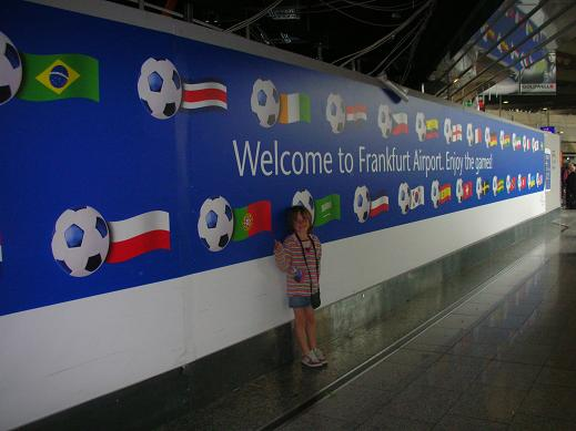 Isabelle at the airport in front of the Fifa's flags