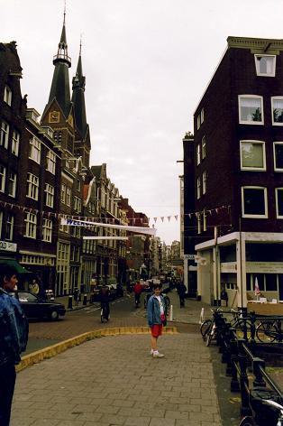 Tara standing on a typical street in Amsterdam