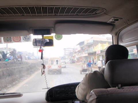 Driving through a Kenya town