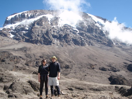 Tara and I in front of Kilimanjaro summit. This photo made the front page of the Auri-Negra.