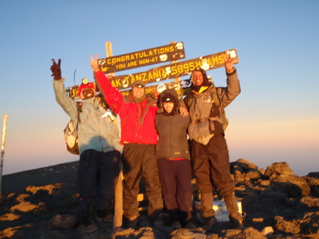 Bryson and Julius and us celebrating on Uhuru Peak