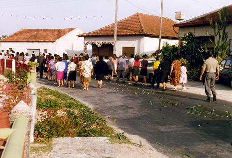 People spread flowers on the street before the procession